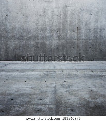 Large raw concrete space. flat concrete wall and floor.  - stock photo
