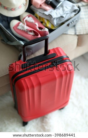 Large red polycarbonate suitcase, close up - stock photo