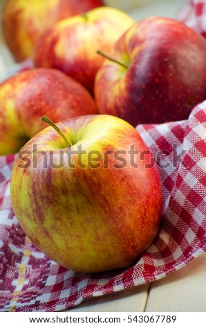 large red ripe apples on the table