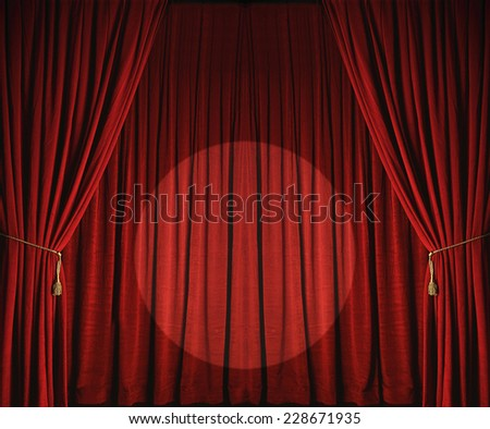 Large red theatre curtains with spotlight - stock photo