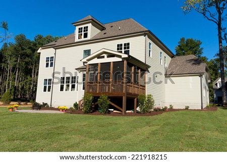 Large residential house with backyard porch and patio  - stock photo