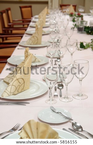large restaurant table set up for a lot of people