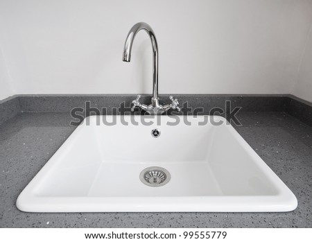 large retro style white ceramic kitchen sink - stock photo