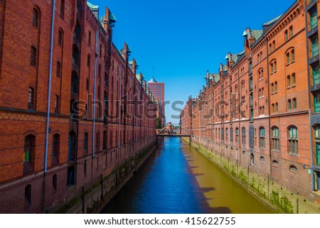 Large river canal in the middle of the city, building on the sides made of bricks