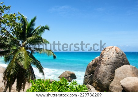 Large Rocks on Beautiful Beach with Turquoise Color Water at Anse Machabee in Mahe Island, Seychelles. An Enchanting Tourist Destination for Vacations. - stock photo