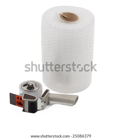 Large roll of bubble wrap and tape dispenser isolated on white - stock photo