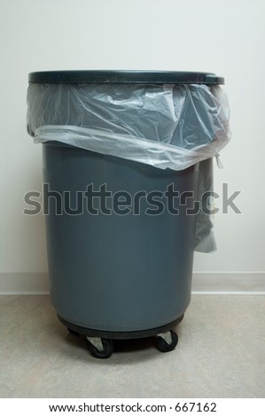 Large Rolling Trash Barrel - stock photo