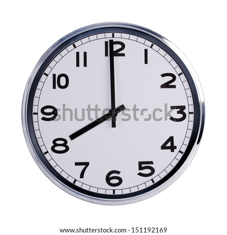 Large round office clock shows eight o'clock