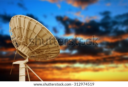 Large satellite antenna under twilight sky background