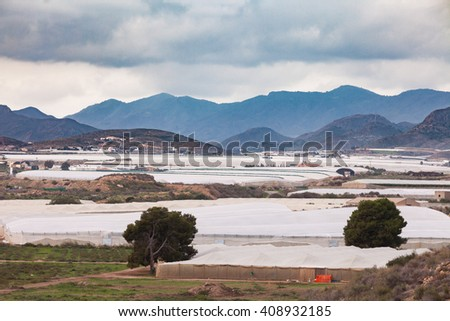 Large scale commercial foil hothouse greenhouses cover huge areas in Spain - stock photo