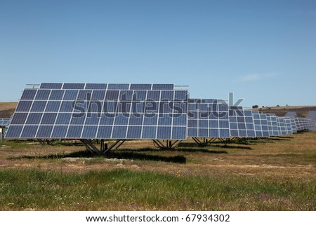 Large scale solar farm in Spain. Solar energy is becoming an important part of the energy mix. - stock photo