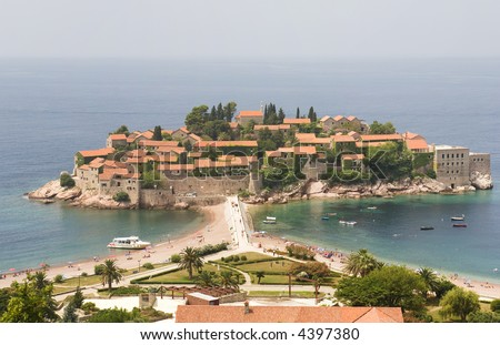 Large-scale view of the Sveti Stefan peninsula in Montenegro taken from an overlook off the local highway.