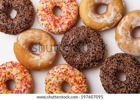 large selection of donuts, many different flavors, shot on white background