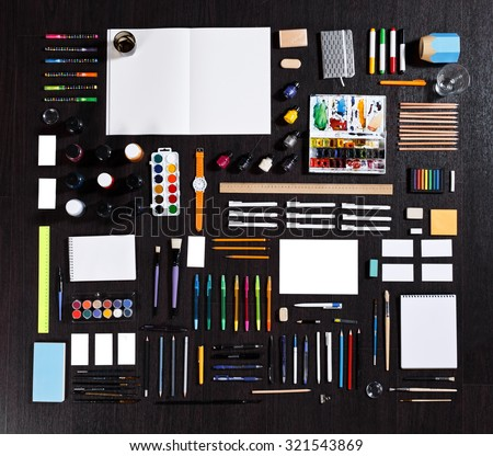 large set of different stationery of artist painter or student. Real photo. pencils, pens, notepads an others stationery on dark background. Modern template - stock photo