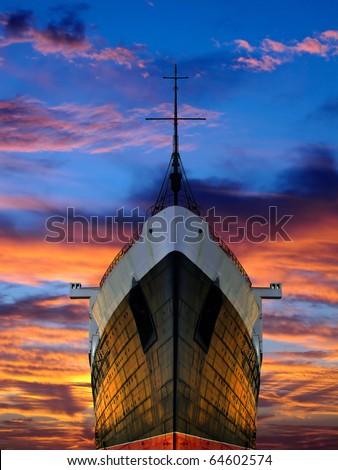 LARGE SHIP HEAD ON SHOT AT SUNRISE - stock photo