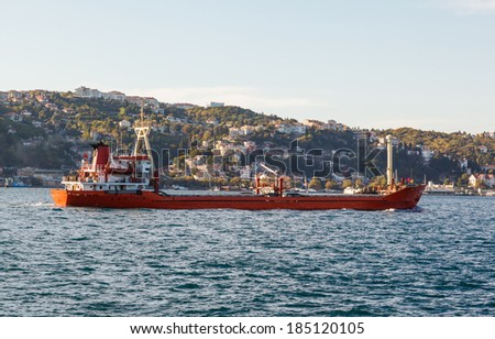large ship tanker proceeding along the Bosphorus coast on the background - stock photo