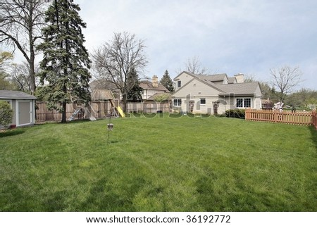 Large side yard of suburban home