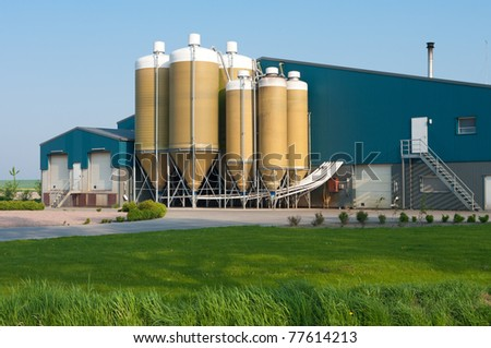large silos in several sizes on a dutch farm - stock photo