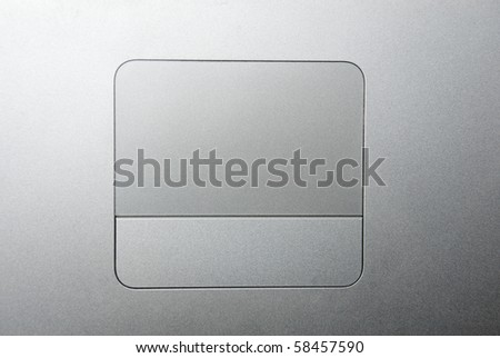 Large silver trackpad and button - stock photo