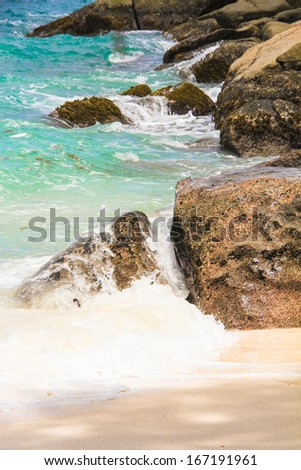 Large smooth stones with turquoise water on the paradise island of Seychelles - stock photo