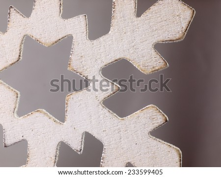 Large snowflake closely. Wooden Christmas ornament in the shape of a snowflake.