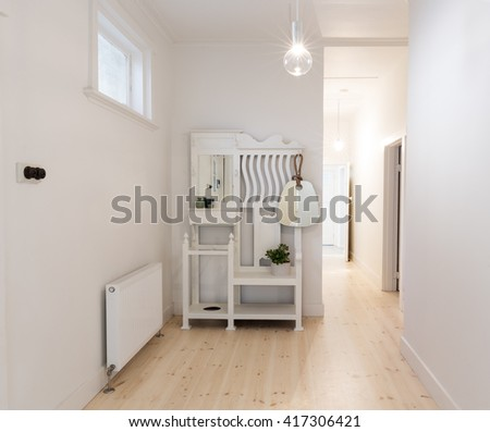 Large spacious entry foyer in beach style decorated art deco apartment - stock photo