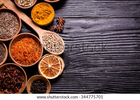 Large spice and herb collection in bowls  on wooden table.healthy food