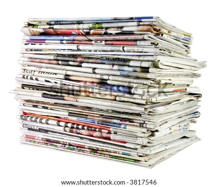 large stack of folded newspapers ready for recycling - stock photo