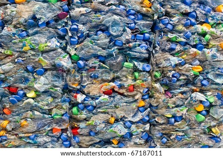 Large stack of old plastic bottles