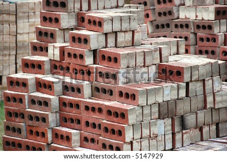 Large stacks of construction grade bricks for home construction. - stock photo