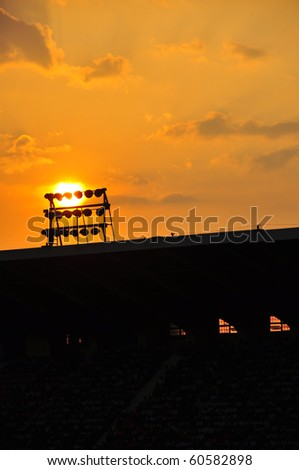 Large stadium in the evening sky is orange with the sunset.