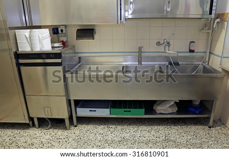 large stainless steel sink of industrial kitchen for preparing food - stock photo