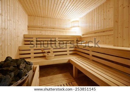 Large standard-design Finland-style classic wooden sauna interior in public building, hotel