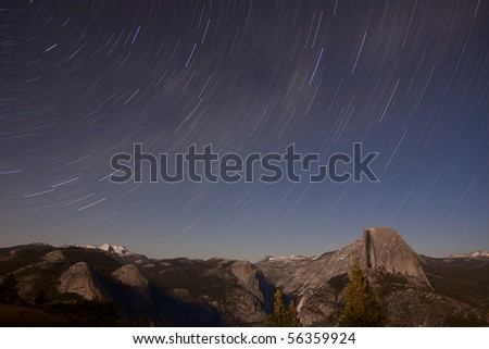 Large Star Trail over Half Dome. Large panorama of star trails over Half Dome in Yosemite National Park - stock photo