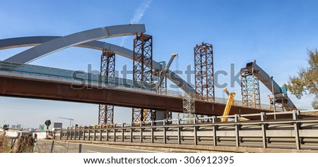 large steel bridge under construction - stock photo