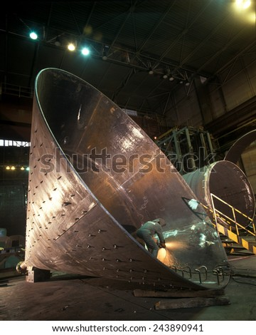Large steel cone being manufactured - stock photo