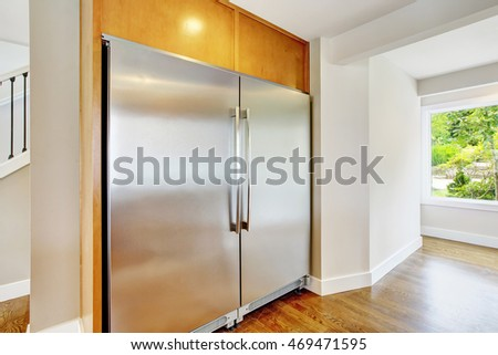 Large steel fridge for a large family built-in kitchen. Northwest, USA