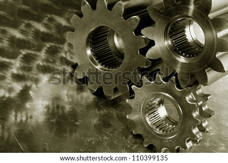 large steel gears and wheels against a titanium background, duplex bronze toning idea - stock photo
