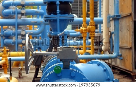 Large steel pipes of an industrial air conditioning cooling system - stock photo