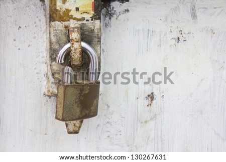 Large strap lock on the steel cable which is not broken apart. - stock photo