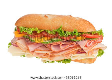 Large sub with fresh veggies, cheese, turkey and ham isolated on white - stock photo
