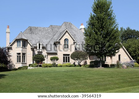 Large suburban home with cedar shake roof - stock photo
