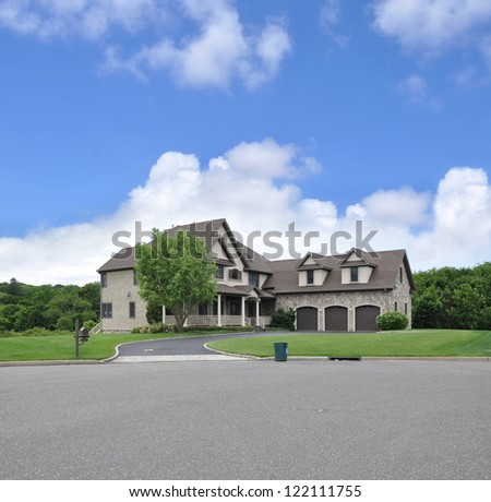 Large Suburban McMansion Home Trash Can Curbside Clouds Blue Sky Day Time - stock photo