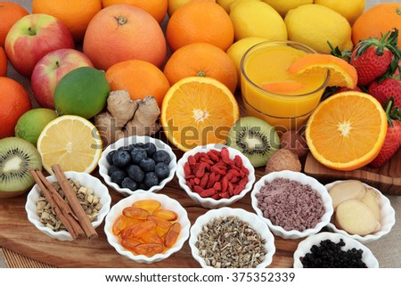 Large super food fruit selection with herbs, spices and supplement capsules for cold and flu remedy including foods high in antioxidants and vitamin c. - stock photo