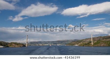Large Suspension Bridge Across a Fjord near Bergen, Norway. Blue Sky with Cloud Formation.