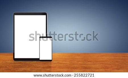Large tablet and smartphone with blank screens on wooden counter top with blue background , copyspace , Mobile devices - stock photo