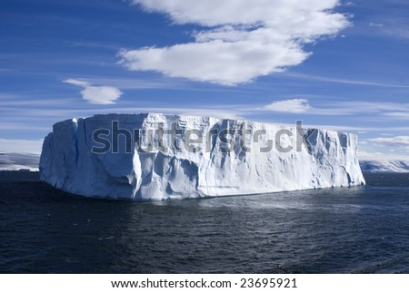 Large tabulator iceberg with clear blue sky