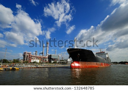 large tanker ship oil transport, A ship in refinery port - stock photo