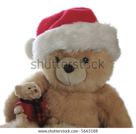 large teddy bear wearing a Santa hat with a little bear in his lap who wears a felt sweater with a red and black muffler - stock photo