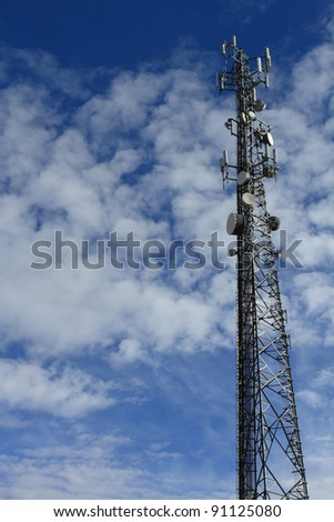 Large telecommunication tower with dramatic clouds in the sky